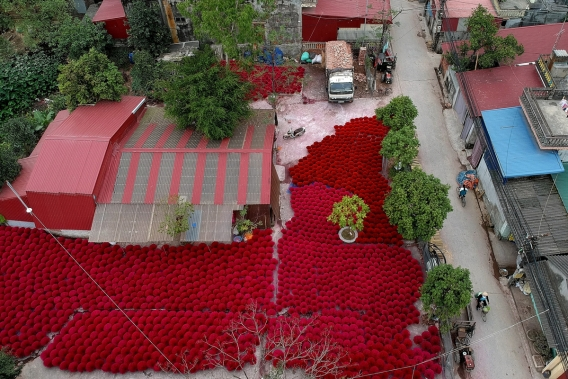 This aerial picture taken on January 4, 2019 shows incense sticks kept in a courtyard for drying in the village of Quang Phu Cau on the outskirts of Hanoi, Vietnam. Photo: AFP