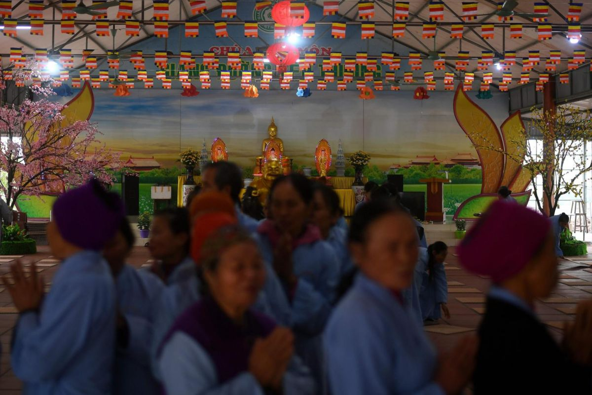 Leprosy survivors offer prayers together with villagers on the 15th day of the lunar month. Photo: AFP
