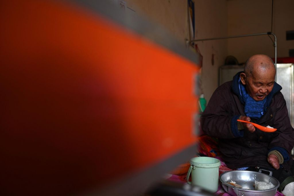 Leprosy survivor Nguyen Quang Chieu, 85, eats his lunch inside his room at the hospice. Photo: AFP