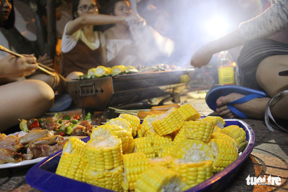 Food is prepared to be grilled at a party. Photo: Tan Hiep / Tuoi Tre