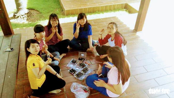 University students enjoy their small party at a park in Ho Chi Minh City. Photo: My Linh / Tuoi Tre