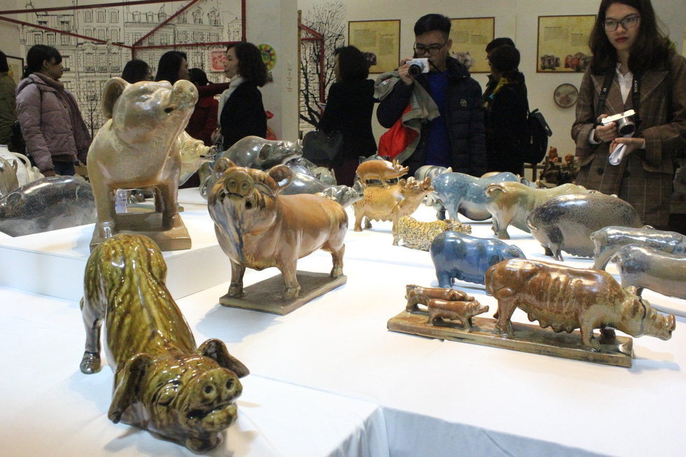 Many visitors are mildly enthralled by the sheer volume of the pig figurines. Photo: Thien Dieu / Tuoi Tre