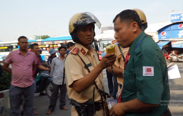 Police test drivers for drug, alcohol use at major bus station in Saigon