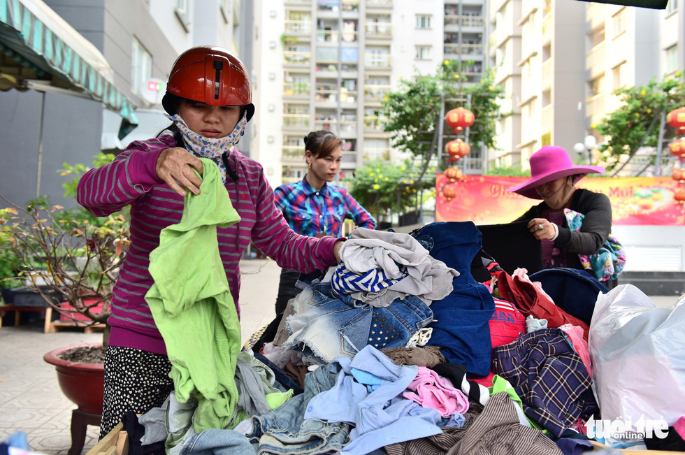 A woman chooses clothes at the Son Ky 1 Apartment Building Complex in Ho Chi Minh City, Vietnam. Photo: Duyen Phan / Tuoi Tre