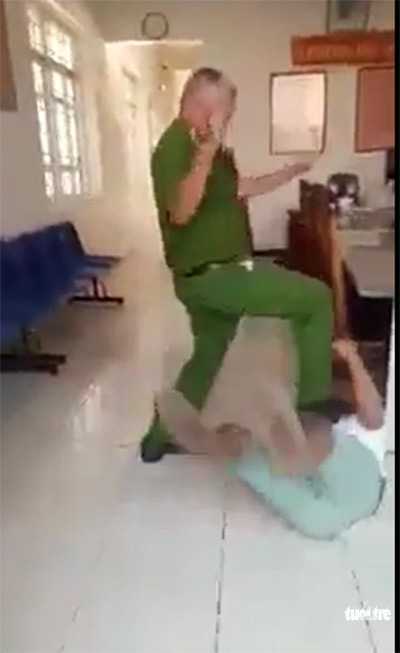 Policeman in Vietnam suspended after being filmed stomping on brawl witness
