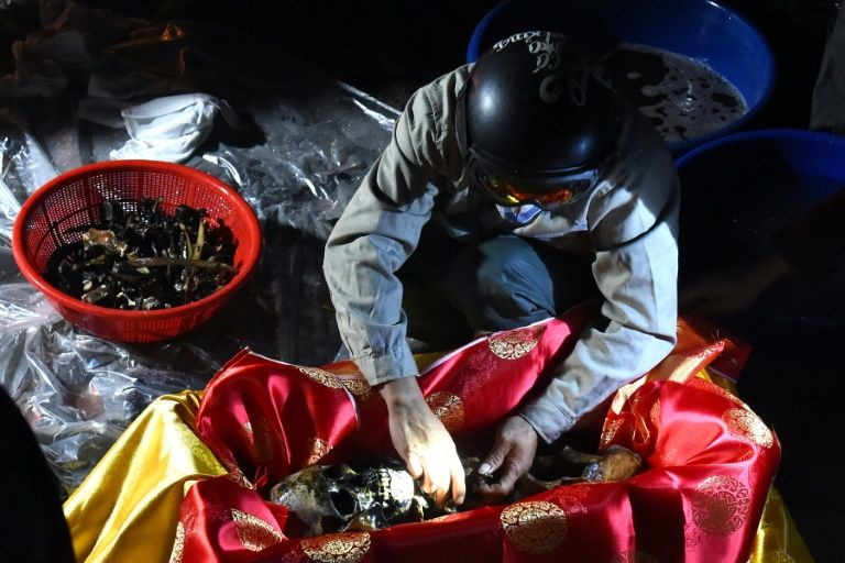 Adherents to the ancient custom in Vietnam believe the souls of the dead are stuck in a spiritual limbo until they are reburied. Photo: AFP