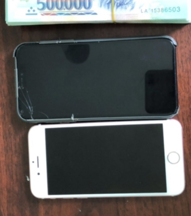 A photo provided by police shows the money and phones returned