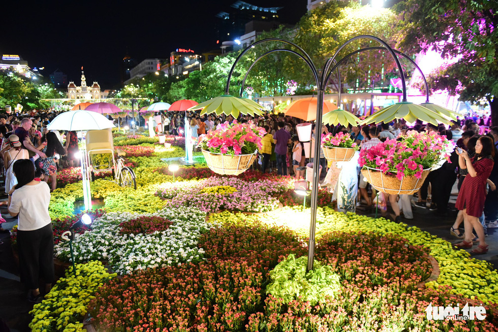 <em>Flowers are seen on the Nguyen Hue Flower Street in Ho Chi Minh City, February 2, 2019. Photo: Quang Dinh / Tuoi Tre
