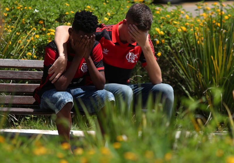Fatal fire exposes poor conditions for young Brazilians