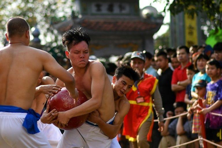 Before the annual showdown each sportsman must train in sports like swimming, running and bodybuilding. Photo: AFP