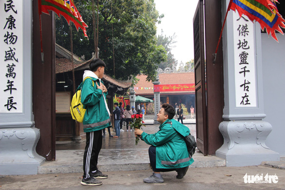 Two boys pose for a funny photo outside the Ha Pagoda in Hanoi. Photo: Ha Thanh / Tuoi Tre