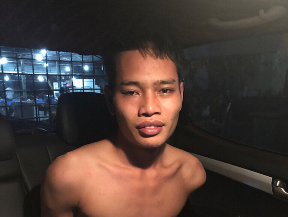 Thach Thanh Tuyen is arrested by police officers on February 18, 2019 in this photo supplied by officers.