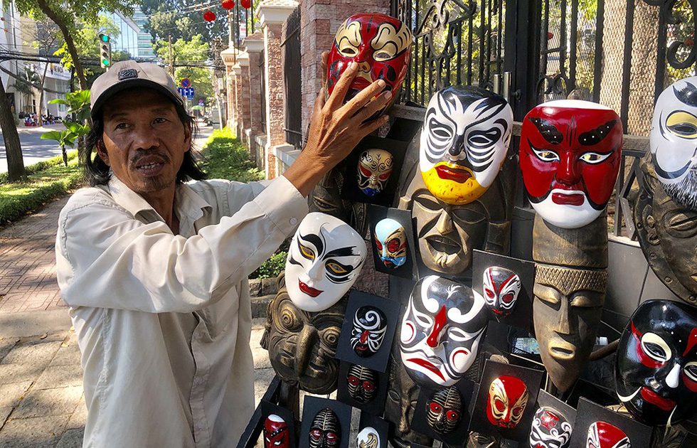 Vietnamese man devotes life to making traditional masks despite their waning popularity