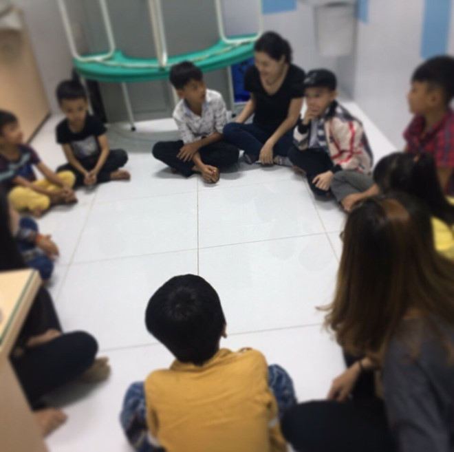 The single mother is in a discussion circle with HIV-infected children. Photo: Supplied