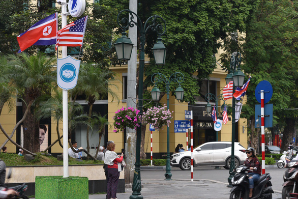The national flags of the U.S. and Democratic People's Republic of Korea are flown on a street in Hanoi. Photo: Duong Lieu / Tuoi Tre