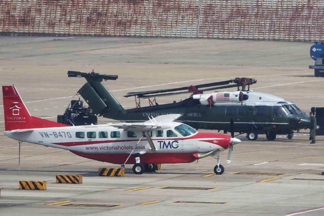 A helicopter (at the back) to be used by U.S. President Donald Trump during his second meeting with North Korea leader Kim Jong Un is unloaded from a Boeing C-17 Globemaster III. Photo: Quang Minh / Tuoi Tre