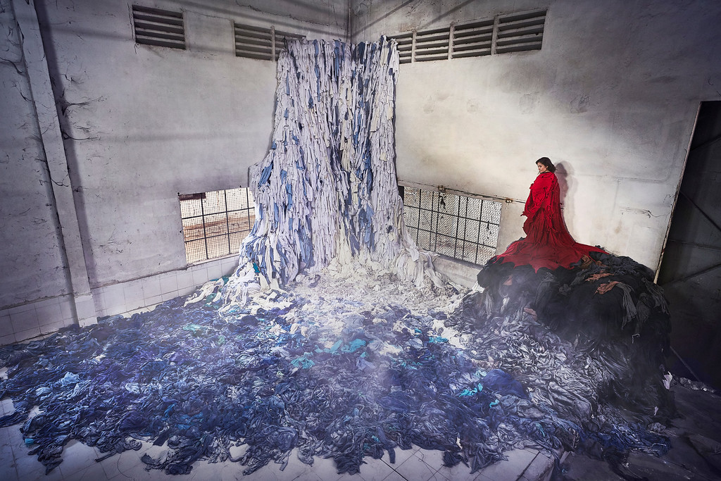 Von Wong's photo captures the giant waterfall of abandoned clothing he made at a bankrupt garment factory in Cambodia