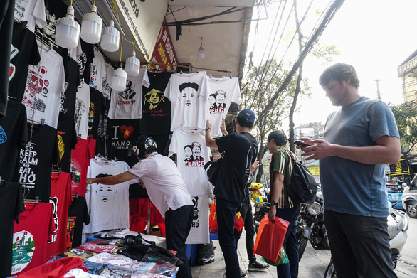 T-shirts printed with illustrations of U.S. President Donald Trump and North Korean leader Kim Jong Un are sold at a clothing store in Hanoi, Vietnam. Photo: Nguyen Hien / Tuoi Tre