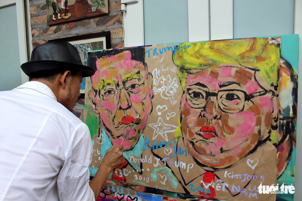 A painting features Kim Jong Un and Donald Trump with each other's hairstyle. Photo: Chi Tue / Tuoi Tre