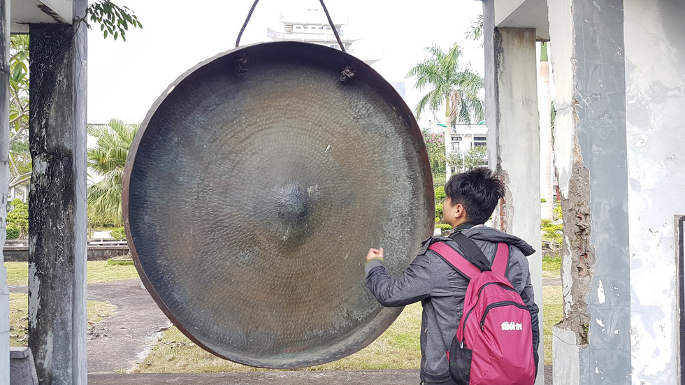 A man hits a gong at the Bui Chu Diocese in Nam Dinh Province, northern Vietnam. Photo: Thai Loc / Tuoi Tre