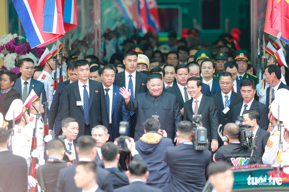 North Korean Chairman Kim Jong Un waves at local media and residents as he walks out of Dong Dang Railway Station in Lang Son Province, northern Vietnam, February 26, 2019. Photo: Viet Dung / Tuoi Tre