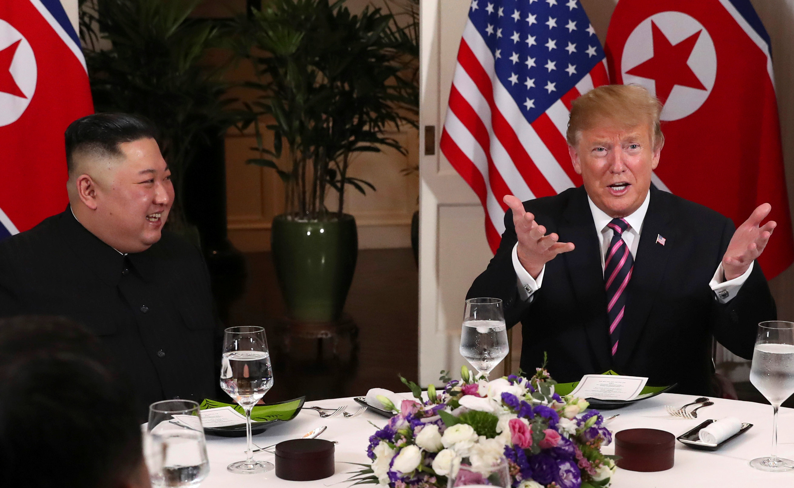 U.S. President Donald Trump gestures as he and North Korean leader Kim Jong Un sit down for a dinner during the second U.S.-North Korea summit at the Metropole Hotel in Hanoi, Vietnam February 27, 2019. Photo: Reuters