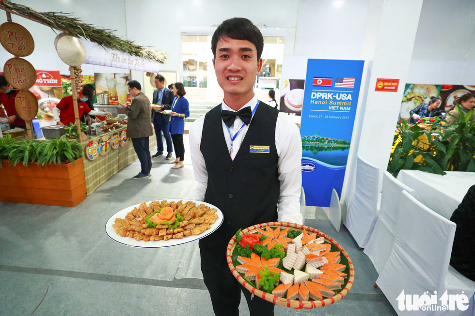 A server presents some of Vietnam's traditional dishes. Photo: Nguyen Khanh / Tuoi Tre