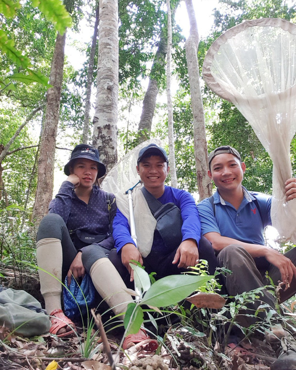 Phan Quoc Toan (first right) poses for a picture with colleagues in a forest in Vietnam. Photo: T.D. / Tuoi Tre