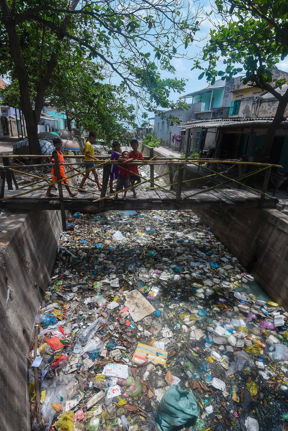 A canal is full of garbage