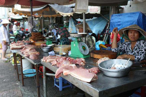 Tran Thi Sen, 49, sells pork at the venue.