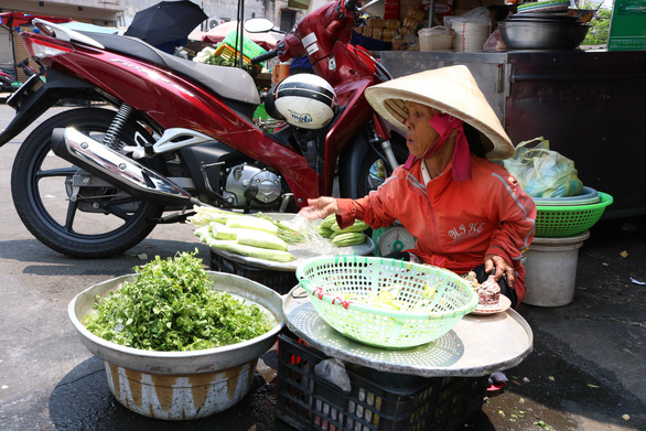Nguyen Thi Lang, 57, said she has been selling vegetables for 20 years.