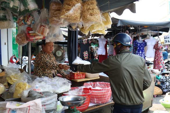 A man buys food at the market.