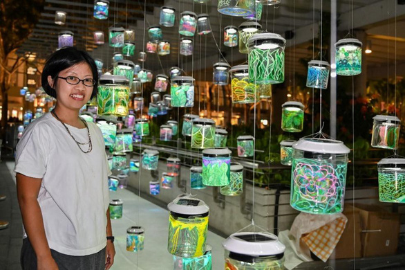 Lee Yun Qin, designer of the Rainbow Connection, is seen next to the arts installation at i Light Singapore 2019 in Singapore in January. Photo: i Light Singapore