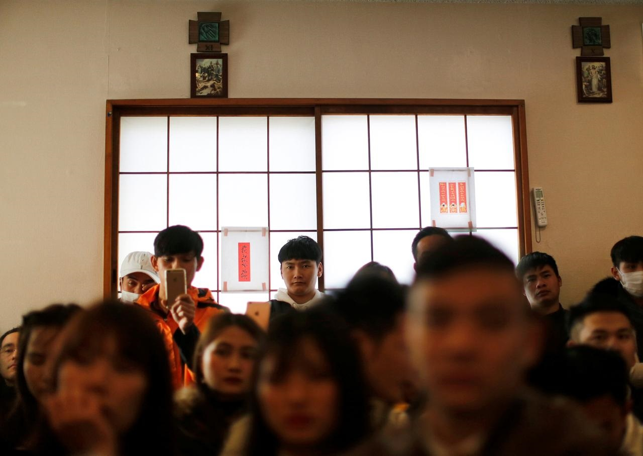 Vietnamese workers, streaming to Japan, face risks as labor system opens up