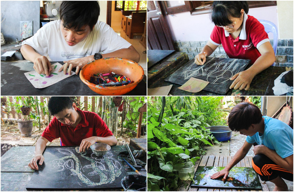 Members of Peaceful Bamboo Family at different stages of painting the pictures. Photo: Tien Vu / Tuoi Tre