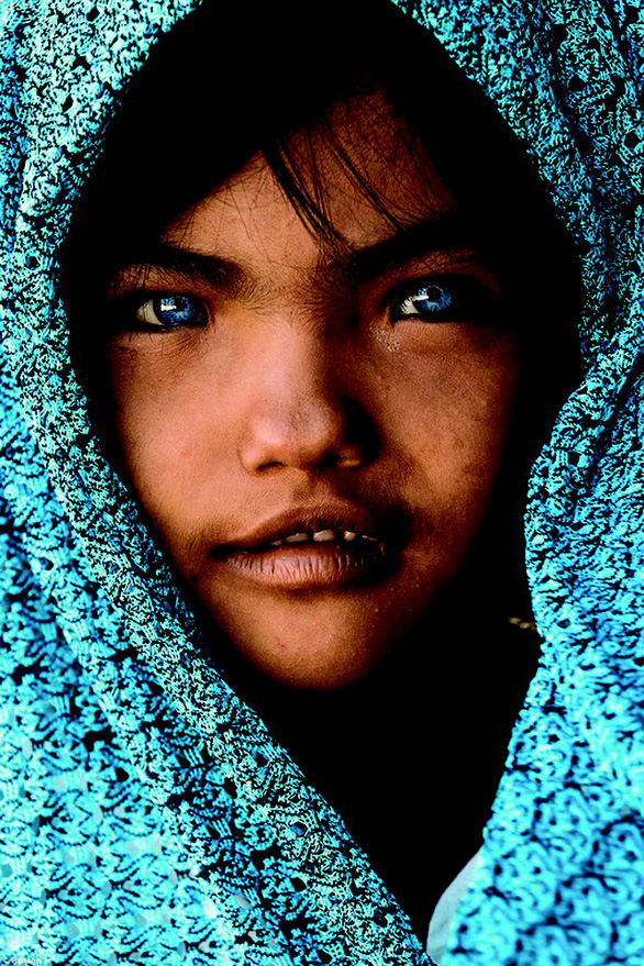 The portrait of a Vietnamese blue-eyed girl of Cham ethnics in the south-central province of Ninh Thuan taken by French photographer Rehahn.