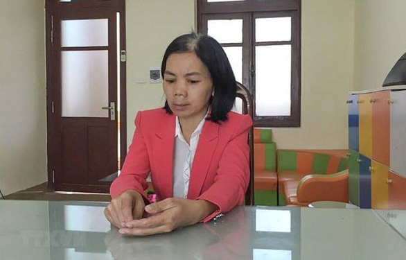 Bui Thi Kim Thu, accused of covering up Duyen's murder, is seen at a police station in Dien Bien Province after her arrest. Photo: Vietnam News Agency