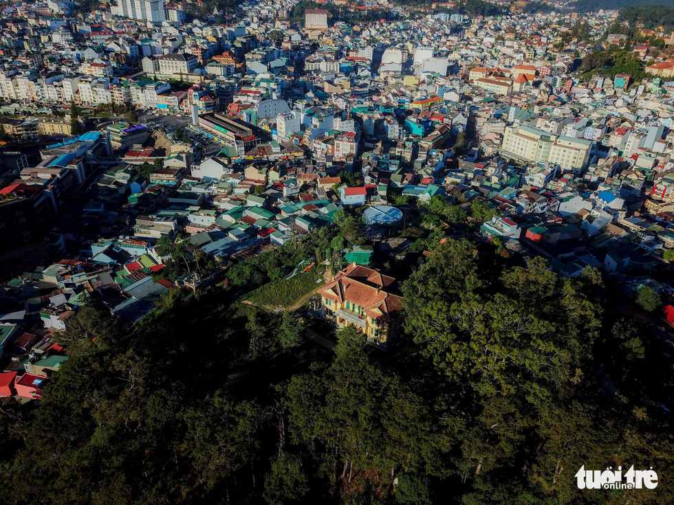 The 'Dinh Tinh Truong' provincial governor's palace sits among a patch of woods on top of a hill in the center of Da Lat, Vietnam. Photo: Mai Vinh / Tuoi Tre