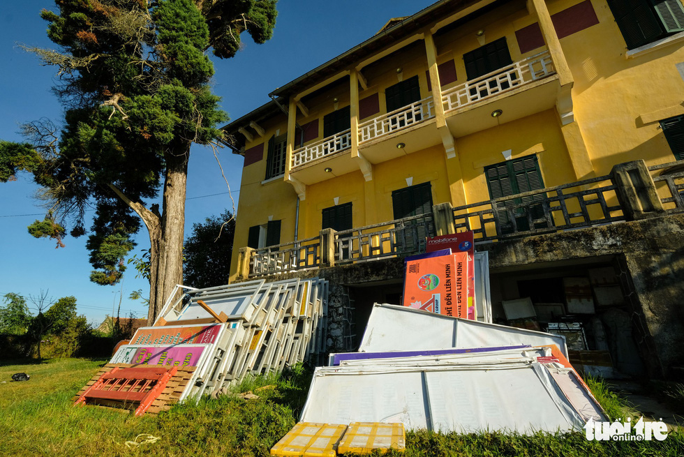 Advertisement billboards are stacked outside the 'Dinh Tinh Truong' provincial governor's palace in Da Lat, Vietnam. Photo: Mai Vinh / Tuoi Tre