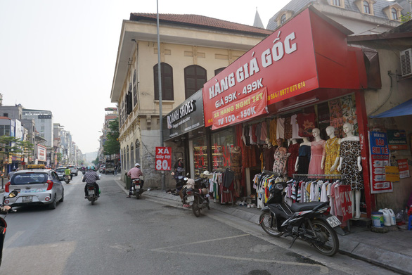 Houses, shops block sidewalks in Hanoi