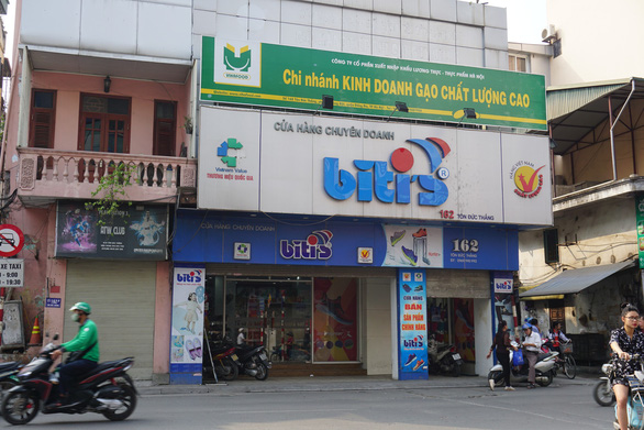 A store encroaches on the sidewalk and roadway along Ton Duc Thang Street.