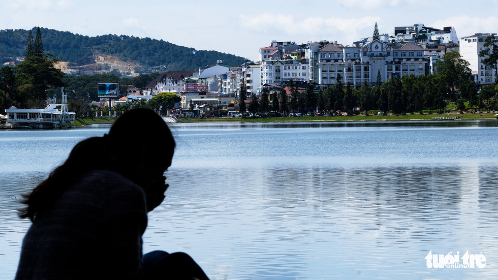 Xuan Huong lake, located in Da Lat city center, is seen surrounded by buildings, apartment, and houses instead of original green spaces. Photo: Tuoi Tre