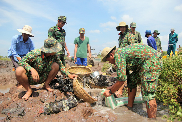 Vietnam authorities start retrieving military plane wreckage kept unreported for seven years