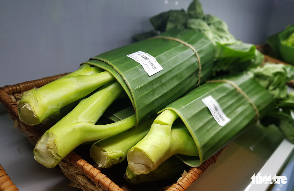 Vegetables wrapped in banana leaves are on sale at Nguyen Anh Thao's store in Binh Thanh District, Ho Chi Minh City. Photo: Ngoc Hien / Tuoi Tre