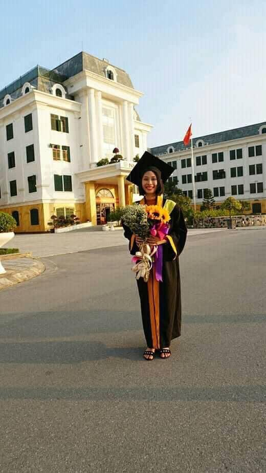 Pham Thi Hue poses in her graduation gown at the end of 2018. Photo: Supplied