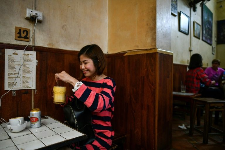 Though many of Hoa's customers have never heard of egg beer, he says he has won most over and sells up to 20 a day. Photo: AFP