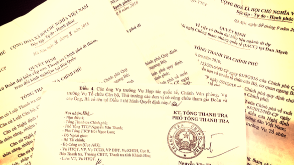 Documents regarding the overseas trips of officials at the government inspectorate. Photo: Than Hoang / Tuoi Tre