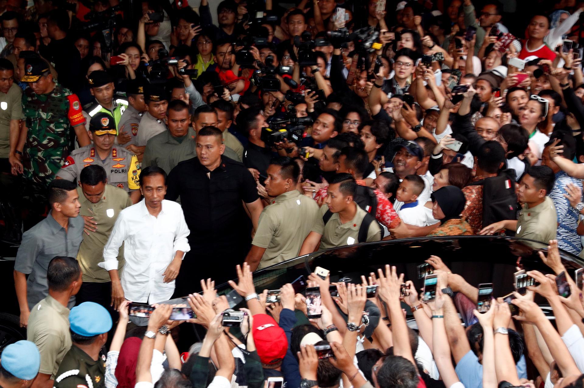 Indonesian 'quick counts' underline Widodo poll win, markets rally