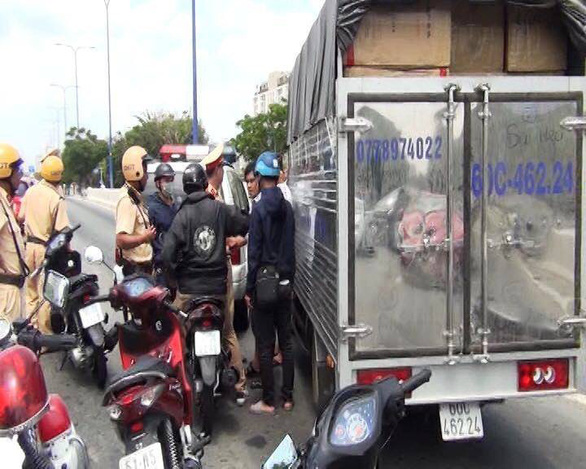 Traffic police officers inspect a truck loaded with meth-containing acoustic speakers in Ho Chi Minh City. Photo: Ho Chi Minh City police
