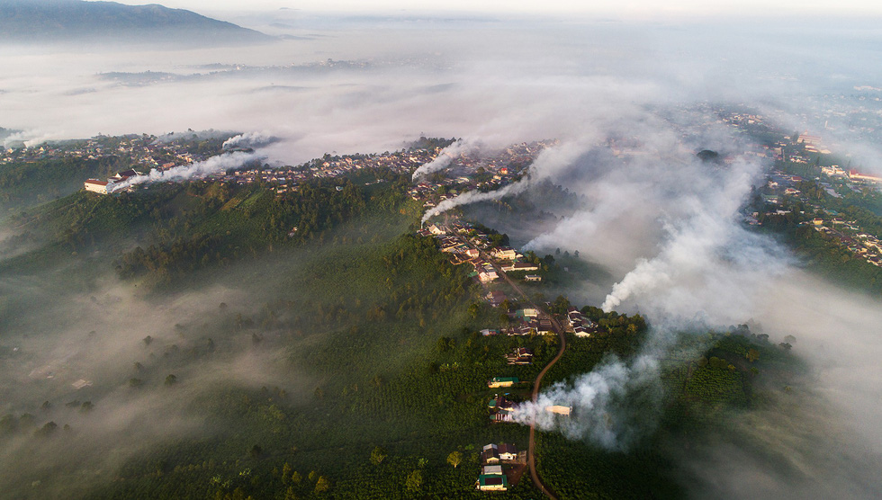 """The runner-up photo, """"Bao Loc covered in smoke"""", by Le Van Cuong."""